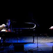 """April 9, 2011 - Manhattan, NY : Ryuichi Sakamoto, left, and Japanese 'Noh' actor Mayo Yamaguchi perform during the Japan Society's 12-hour-long special """"Concert For Japan"""" charity event on Saturday.  (This was taken during the 6-7:20pm Gala Block)... CREDIT: Karsten Moran for The New York Times."""