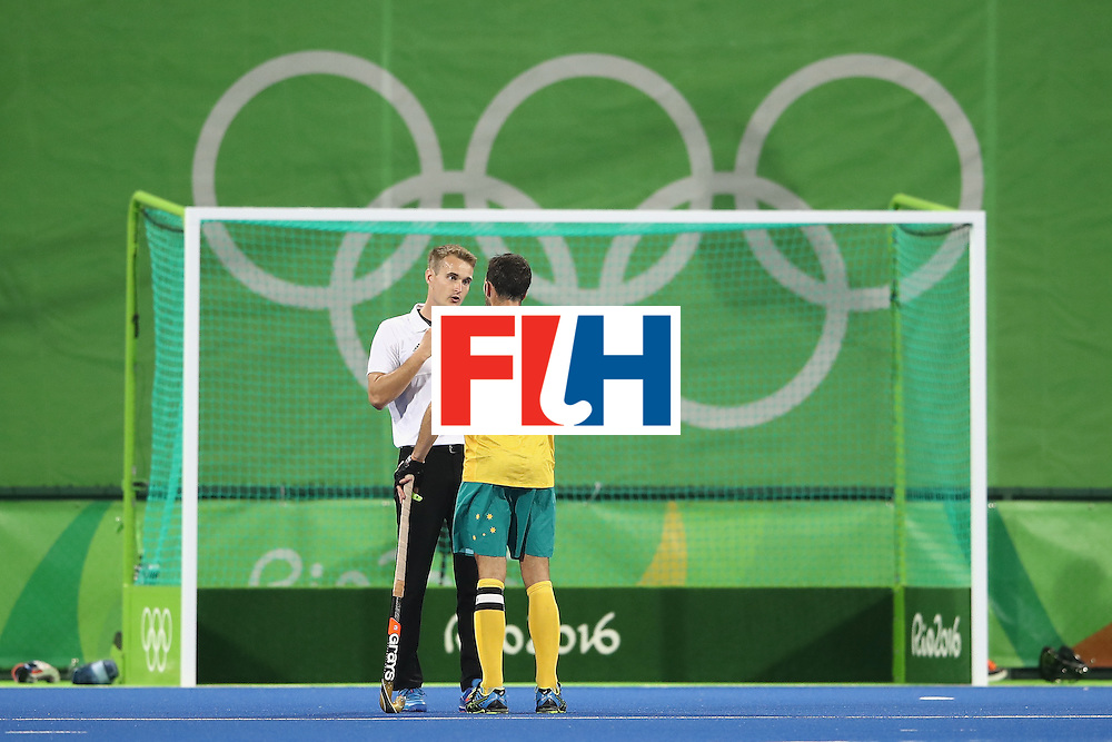 RIO DE JANEIRO, BRAZIL - AUGUST 10:  Mark Knowles Australia makes his point to the umpire during the men's pool A match between Great Britain and Australia on Day 5 of the Rio 2016 Olympic Games at the Olympic Hockey Centre on August 10, 2016 in Rio de Janeiro, Brazil.  (Photo by Mark Kolbe/Getty Images)