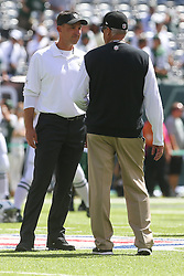 EAST RUTHERFORD, NJ - SEPTEMBER 7: head coach Dennis Allen of the Oakland Raiders and head coach Rex Ryan of the New York Jets talk before their game at MetLife Stadium on September 7, 2012 in East Rutherford, NJ.  (Photo by Ed Mulholland/Getty Images)