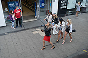 During the Coronavirus pandemic, when social distancing and partying is being discouraged, a group of hen party women walk through Waterloo, one of whom is swigging from a bottle of booze, on 29th August 2020, in London, England,