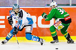 Martin Grabher Meier (EHC Liwest Linz, #91) and Eric Pance (HDD Tilia Olimpija, #30) during ice-hockey match between HDD Tilia Olimpija and EHC Liwest Black Wings Linz at fourth match in Semifinal  of EBEL league, on March 13, 2012 at Hala Tivoli, Ljubljana, Slovenia. (Photo By Matic Klansek Velej / Sportida)