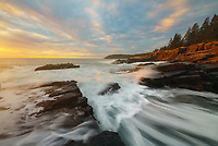 Wonderful interplay of colorful clouds and waves along the Atlantic coast at sunrise in Acadia National Park, ME, USA
