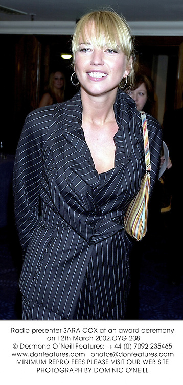 Radio presenter SARA COX at an award ceremony on 12th March 2002.OYG 208