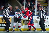 KELOWNA, CANADA - MARCH 3: Colum McGauley #23 of the Kelowna Rockets drops the gloves with Riley McKay #27 of the Spokane Chiefs in the first period on March 3, 2018 at Prospera Place in Kelowna, British Columbia, Canada.  (Photo by Marissa Baecker/Shoot the Breeze)  *** Local Caption ***