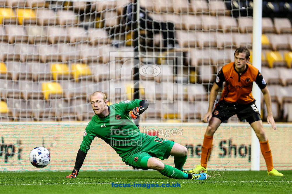 Aaron McCarey of Wolverhampton Wanderers is beaten but the ball goes wide during the Capital One Cup match at Molineux, Wolverhampton<br /> Picture by Andy Kearns/Focus Images Ltd 0781 864 4264<br /> 12/08/2014