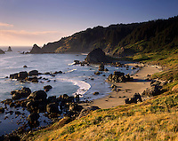 Evening light on rocky shore of Cape Ferrelo Oregon USA