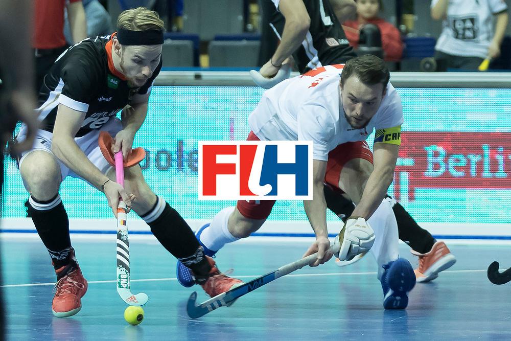 Hockey, Seizoen 2017-2018, 08-02-2018, Berlijn,  Max-Schmelling Halle, WK Zaalhockey 2018 MEN, Poland - Germany 3-6, ZYWICZKA Bartosz (C) (POL) en RÜHR Christopher (GER).