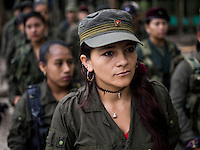 Casika Atahualpa stands in formation with fellow FARC rebels in a camp in the remote Putumayo region of Colombia, on December 11, 2016. (Photo/Scott Dalton)
