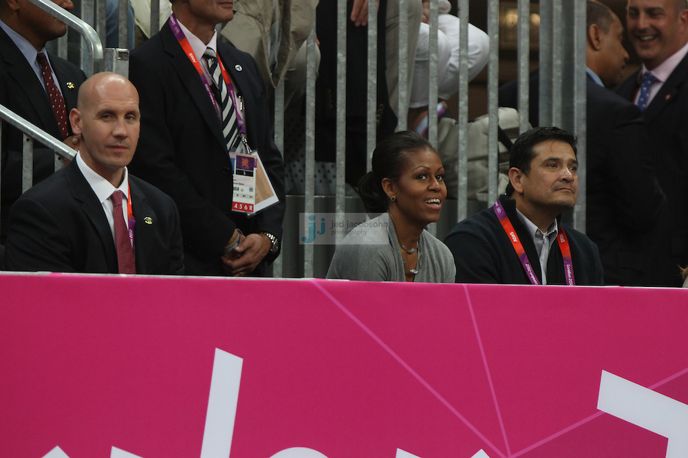 First Lady Michelle Obama looks on during a USA basketball game against France during Day 2 of the London Olympic Games in London, England, United Kingdom on 29 Jul 2012..(Jed Jacobsohn/for The New York Times)....