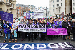 London, UK. 19th January, 2019. Women from WASPI London prepare to join thousands of other women taking part in the Global Women's March from BBC Broadcasting House to Trafalgar Square to attend a Bread & Roses Rally Against Austerity organised by Women's March London. Inspired by the 1912 Bread & Roses protests which revolutionised workers' rights for women and in the light of Brexit, the organisers called for assurances from the Government in ending policies of austerity which lead to economic oppression, violence against women, the gender pay gap, racism, fascism, institutional sexual harassment and the hostile environment experienced by marginalised groups.