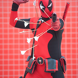 London, UK - 26 May 2013: Karl Daniel dressed as Dead Pool of Marvel poses for a picture during the London Comic Con 2013 at Excel London. London Comic Con is the UK's largest event dedicated to pop culture attracting thousands of artists, celebrities and fans of comic books, animes and movie memorabilia.