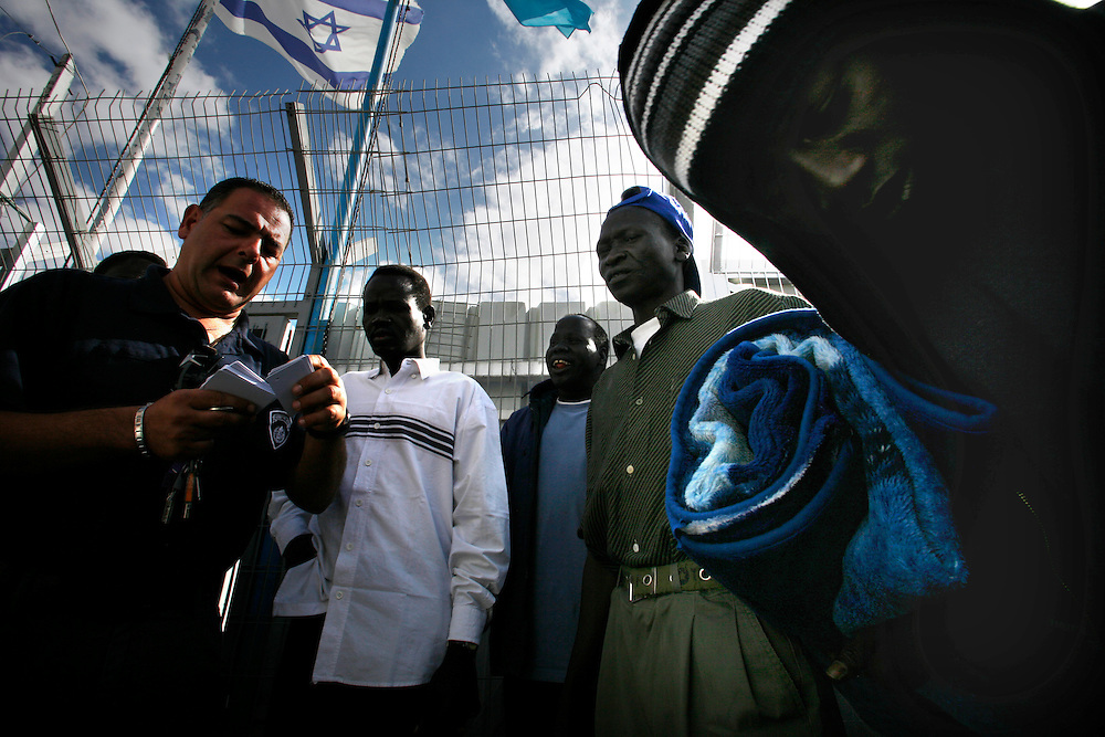 Sudanese refugees at a detention center in Qeziot, Israel, on Monday, Nov. 2, 2007. The refugees come from war-torn regions of Sudan, including Darfur and the south,  where civil strife has raged for more than two decades. After crossing the Egyptian-Israeli border in Sinai by foot, the refugees have been confined to an Israeli detention camp for several months while are interviewed and seek political asylum. Israel has tried to place the refugees outside the camps and find them work..... ..