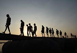 November 1, 2018 - Allahabad, Uttar Pradesh, India - Laborers making a temporary pontoon bridge on River Ganga ahead of Kumbh 2019 during Sunset in Allahabad. (Credit Image: © Prabhat Kumar Verma/ZUMA Wire)