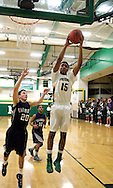 Northmont junior Dominique Stollings (15) grabs a rebound as the Fairmont Firebirds play the Northmont Thunderbolts at Northmont High School in Clayton, Friday, December 16, 2011.