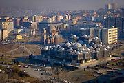 """The Skyline of Pristina including the National Library of Kosovo """"Pjetër Bogdani"""" and the incomplete  Christ the Saviour Serbian Orthodox Cathedral, on the 13th of December 2018, Pristina, Kosovo.  Pristina is  the capital and largest city of Kosovo, it has a mainly Albanian population along with other smaller communities. (photo by Andrew Aitchison / In pictures via Getty Images)"""