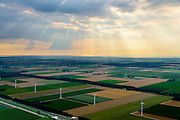 Nederland, Flevoland, Zeewolde, 05-08-2014; zon breekt door de wolken boven windmolenpark in de Flevopolder.<br />