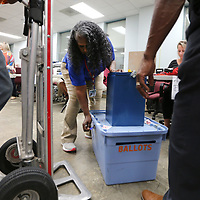 Jacque Grayson, Lee County district four election commissioner checks in ballots at her station as the results come in on Tuesday night.
