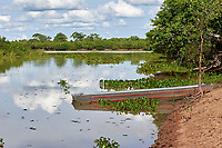 Boat on edge of Claro River,  Mato Grosso, Brazil (Photo: Peter Llewellyn)