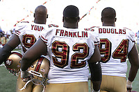Oct 21, 2007: East Rutherford, NJ, USA: San Francisco 49ers defensive end (97) Bryant Young, nose tackle (92) Aubrayo Franklin, and defensive end (94) Marques Douglas stand on the sideline while the offense is on the field playing against the New York Giants during the second half at Giants Stadium. Giants won 33-15..