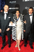 8 February -Washington, D.C: (L-R) Willie Wilkerson, Recording Artist Aretha Franklin and Guest attend the BET Honors 2014 Red Carpet held at the Warner Theater on February 8, 2014 in Washington, D.C.  (Terrence Jennings)