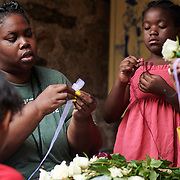 Campers learn aspects of floral design by making corsages, boutonnieres, and wristlets.<br /> at Bartram's Garden<br /> August 14, 2019