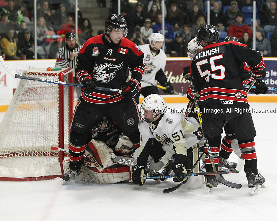TRENTON, ON  - APR 15,  2017: Ontario Junior Hockey League, Championship Series. Georgetown Raiders vs the Trenton Golden Hawks in Game 2 of the Buckland Cup Final. Max Ewart #51 of the Trenton Golden Hawks and Jacob Payette #6 of the Georgetown Raiders become involved in an altercation in the crease area during the second period.<br /> (Photo by Tim Bates / OJHL Images)