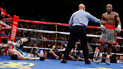 K.M. CANNON/REVIEW-JOURNALFloyd Mayweather of Las Vegas knocks down Ricky Hatton of Britain in the 10th round of their WBC World Welterweight Championship bout at the MGM Grand Garden Arena Saturday, Dec. 8, 2007. Mayweather went on to knock Hatten out later in the round...