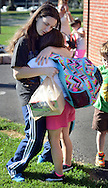 LOWER SOUTHAMPTON, PA - AUGUST 28:   Jessica Heitz, of Feasterville, Pennsylvania hugs her daughter Skylar Heitz, 7 at the start of the first full day of school at Lower Southampton Elementary School August 28, 2014 in Lower Southampton, Pennsylvania. (Photo by William Thomas Cain/Cain Images)