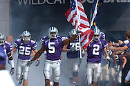 Kansas State's Thomas Clayton (5) leads the Wildcats out of the locker room before their game with Louisville at Bill Snyder Family Stadium in Manhattan, Kansas, September 23, 2006.  The 8th ranked Louisville Cardinals beat K-State 24-6.