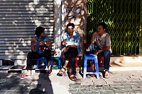 Local workers sit down for a morning coffee streetside in District 1, Ho Chi Minh City, Vietnam.