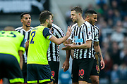 Tommy Smith (#2) of Huddersfield Town protests with Florian Lejeune (#20) of Newcastle United after being issued a red card for a challenge on Miguel Almiron (#24) of Newcastle United during the Premier League match between Newcastle United and Huddersfield Town at St. James's Park, Newcastle, England on 23 February 2019.