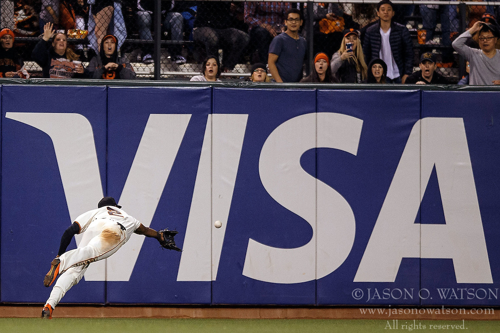 SAN FRANCISCO, CA - APRIL 18: Denard Span #2 of the San Francisco Giants dives for but is unable to catch a fly ball hit off the bat of Yasmany Tomas (not pictured) of the Arizona Diamondbacks during the eighth inning at AT&T Park on April 18, 2016 in San Francisco, California. The Arizona Diamondbacks defeated the San Francisco Giants 9-7 in 11 innings.  (Photo by Jason O. Watson/Getty Images) *** Local Caption *** Denard Span