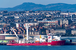 View over city of Dundee  with offshore oil industry support ships moored on waterfront in Tayside, Scotland, United Kingdom