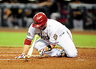 Sep. 20 2011; Phoenix, AZ, USA; Arizona Diamondbacks infielder .Aaron Hill (2) is hit by a pitch during the fifth inning against the Pittsburgh Pirates at Chase Field. Mandatory Credit: Jennifer Stewart-US PRESSWIRE