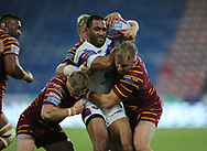 Aaron Murphy (R) of Huddersfield Giants tackles Bill Tupou of Wakefield Trinity during the Betfred Super League Super 8's match at the John Smiths Stadium, Huddersfield<br /> Picture by Stephen Gaunt/Focus Images Ltd +447904 833202<br /> 31/08/2018