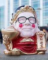 A Warren Buffett version of Caishen, the Chinese god of wealth and prosperity, brought by Yun Fei Fei of China to the Berkshire Hathaway annual shareholders meeting at the CenturyLink Center on Saturday, May 6, 2017, in Omaha.<br /> <br /> MATT DIXON/THE WORLD-HERALD