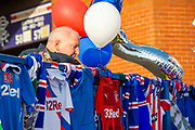 A fan studies the tributes at impromptu memorial on the gates of Ibrox Stadium, Glasgow, Scotland to Fernando Ricksen, the former Rangers player, who sadly passed away the day before the Europa League match between Rangers FC and Feyenoord Rotterdam on 19 September 2019.