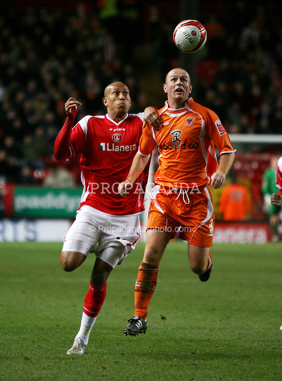 London, England - Saturday, January 12th, 2008:  Charlton Athletic's Chris Iwelumo in action against Blackpool's Michael Jackson during the League Championship match at The Valley. (Pic by Chris Ratcliffe/Propaganda)