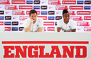 Frank Lampard (L) and Raheem Sterling speak to the media during the England press conference at Est&aacute;dio Claudio Coutinho, Rio de Janeiro<br /> Picture by Andrew Tobin/Focus Images Ltd +44 7710 761829<br /> 17/06/2014