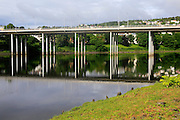 Elgeseter Bridge reflected in water of Nidelva river, Trondheim, Norway