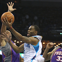 Feb 01, 2010; New Orleans, LA, USA; New Orleans Hornets guard Marcus Thornton (5) drives past Phoenix Suns center Channing Frye (left) and forward Grant Hill (33) during the second half at the New Orleans Arena.The Suns defeated the Hornets 109-100. Mandatory Credit: Derick E. Hingle-US PRESSWIRE