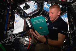 EARTH Aboard the International Space Station -- 28 Feb 2016 -- British ESA astronaut Tim Peake reads a copy of Isaac Newton's Philosophiae Naturalis Pricipia Mathematica (in Latin) during some rare time off aboard the International Space Station as his Principia mission continues. EXPA Pictures © 2016, PhotoCredit: EXPA/ Photoshot/ Atlas Photo Archive/NASA<br />