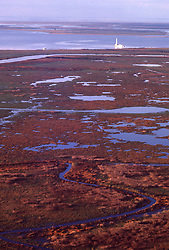 Stock photo of an offshore barge drilling rig in marshes of south Louisiana.