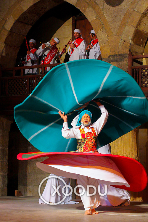 Arab sufi dancer (whirling dervish) costume, Cairo, Egypt (January 2008)
