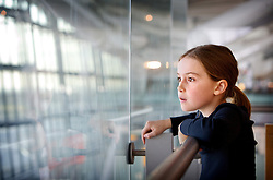 Heathrow Airport, Terminal 5A, airside, child looking out to apron area, October 2008. Image ref CHE05326d, AC MR