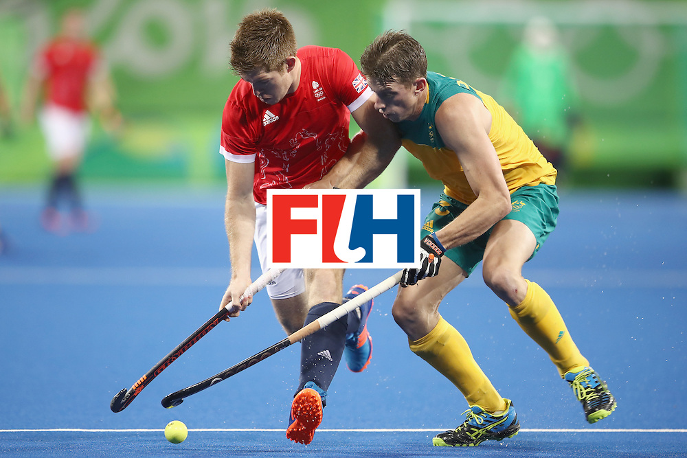 RIO DE JANEIRO, BRAZIL - AUGUST 10:  Henry Weir of Great Britain and Simon Orchard of Australia compete for the ball during the men's pool A match between Great Britain and Australia on Day 5 of the Rio 2016 Olympic Games at the Olympic Hockey Centre on August 10, 2016 in Rio de Janeiro, Brazil.  (Photo by Mark Kolbe/Getty Images)