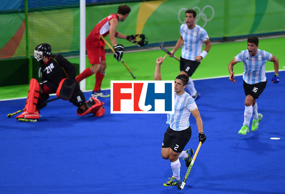 Argentina's Gonzalo Peillat (bottom) celebrates after scoring a goal during the men's Gold medal field hockey Belgium vs Argentina match of the Rio 2016 Olympics Games at the Olympic Hockey Centre in Rio de Janeiro on August 18, 2016. / AFP / MANAN VATSYAYANA        (Photo credit should read MANAN VATSYAYANA/AFP/Getty Images)