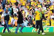 London - Saturday, April 17th 2010: Norwich City fans invade the pitch after the Coca Cola League One match at Carrow Road, Norwich..(Pic by Alex Broadway/Focus Images)
