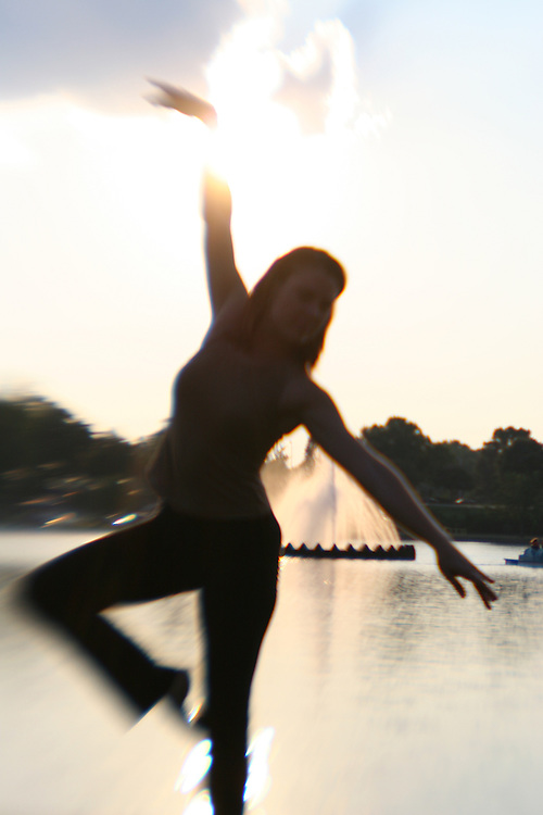 Woman dancing in front of water