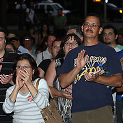 Orlando residents clap during an Occupy Orlando public demonstration in support of Occupy Wall Street gatherings across the country, at the Orange County History Center on Wednesday, October 5, 2011 in Orlando, Florida. (AP Photo/Alex Menendez)